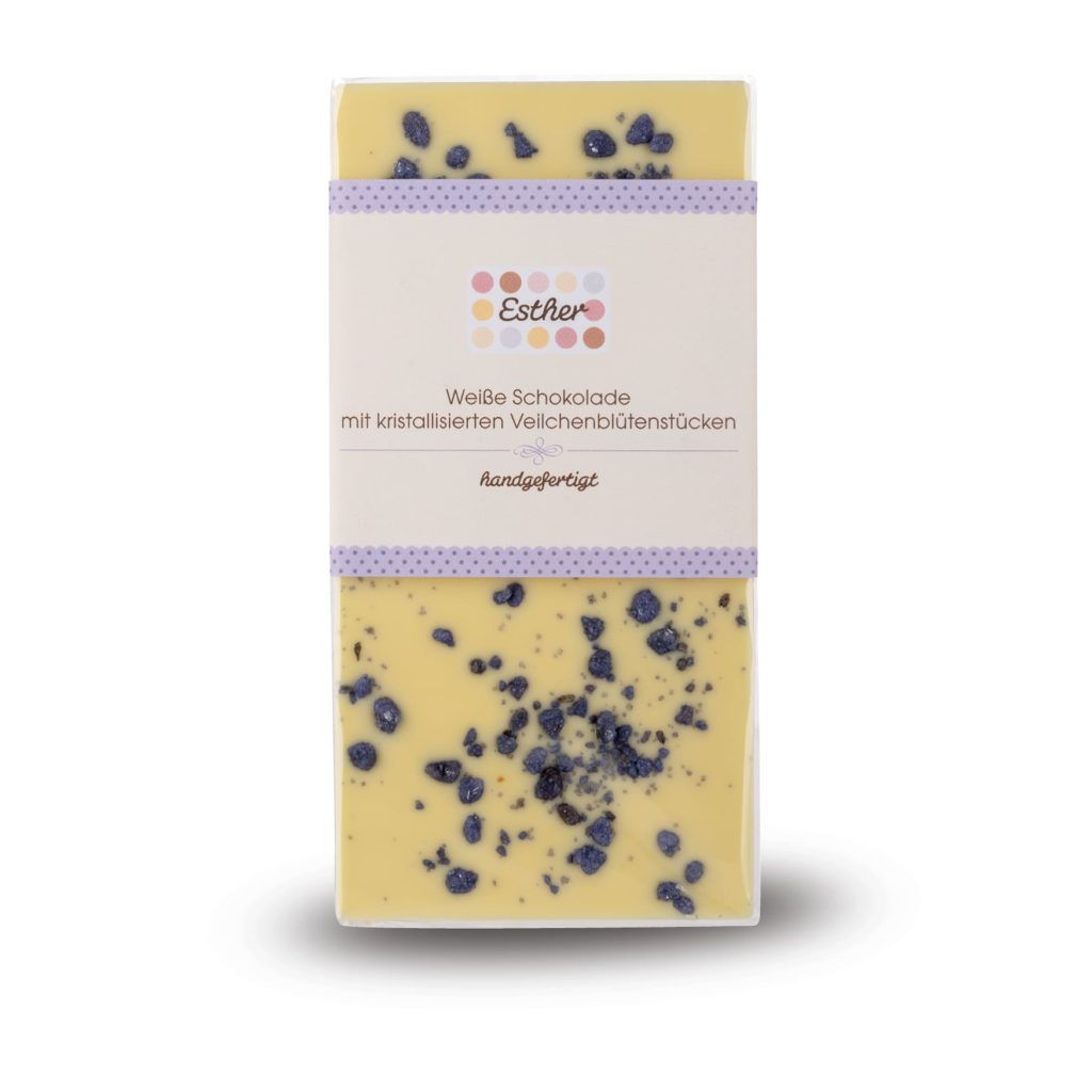 Weiße Schokolade mit kandierten Veilchenstücken als 100g Schokoladentafel der Esther Confiserie aus Kulmbach in Oberfranken